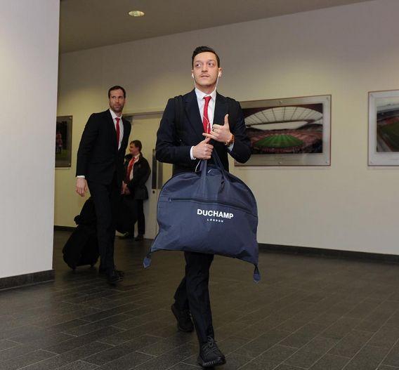 Mesut Ozil and Petr Cech